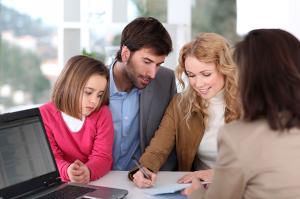 Couple-and-child-buying-house---Stock-Image